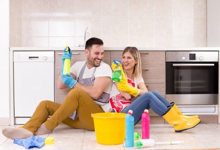 Young couple having fun with chores
