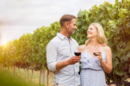 Couple drinking in vineyard